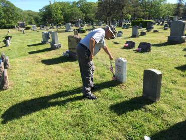 George Egan laying flags for Memorial Day