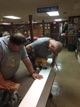 Commander Barrett and Tony working on the new bar bathroom