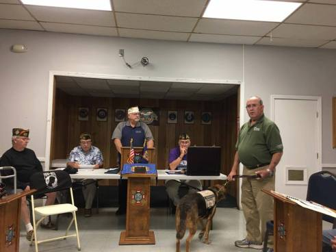 Commander Barrett giving funds from our fundraiser to VetDOGS